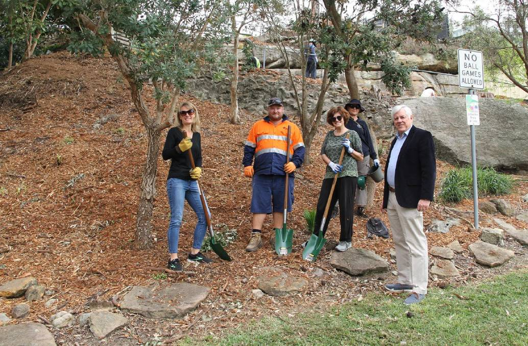 Georges River Council mayor Kevin Greene, right, with volunteers at the recent Spark Your Park planting event at Charles Street Reserve, Oatley. The plants were later stolen by thieves.