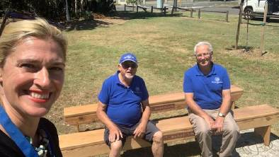 Great work: Sans Souci Girl Guides president Lorena Lys with Louis and Fred from the Men's Shed sitting on the benches they lovingly restored. Picture: Supplied.