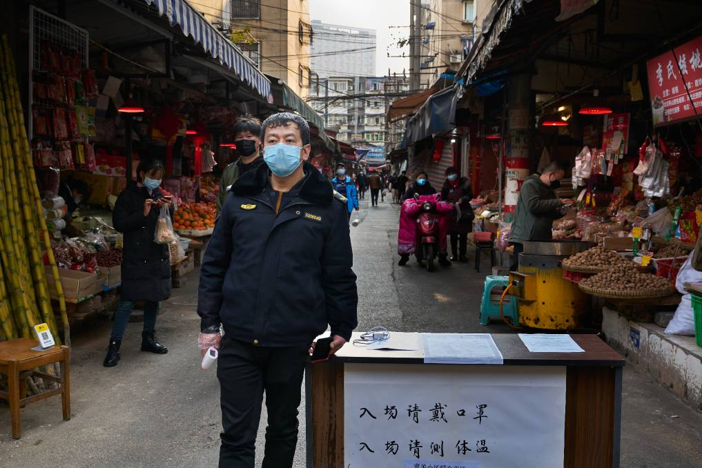 A Wuhan market security guard at the start of the pandemic. Picture: Shutterstock