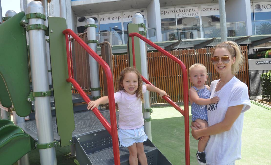 Jade Carroll, with Isla, 3, and Lachlan, 16 months, is very pleased the council is reconsidering getting rid of the playground in the mall.
