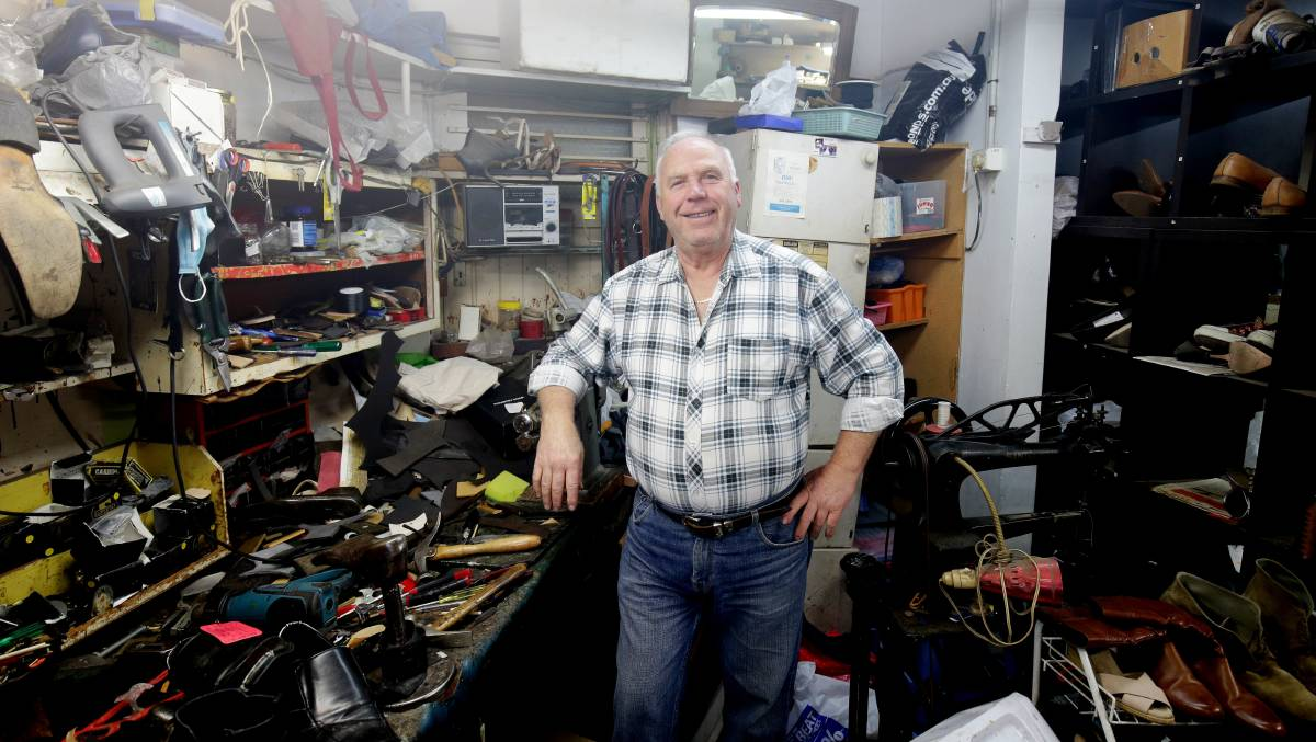 Jack Faris in his shoe repair shop at Caringbah which is closing. Picture: Chris Lane