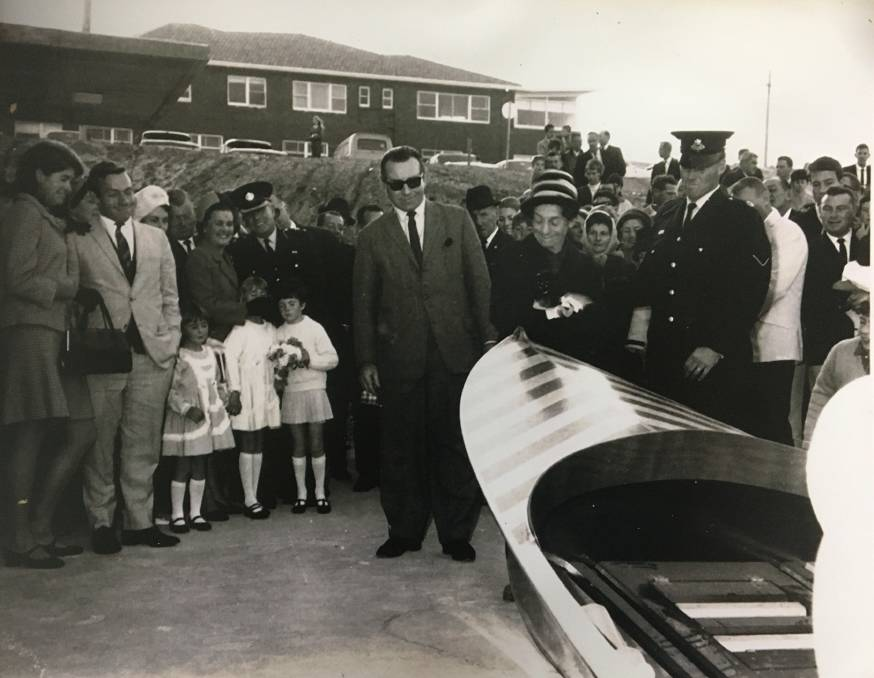 First of many: Charlotte Breen, with her husband Thomas launches the first of 11 surfboats named after her at Elouera beach in 1967. Picture: Elouera SLSC