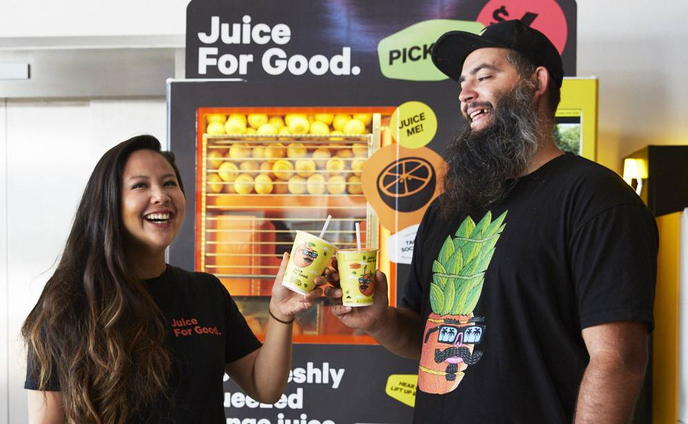 Collab: Louise Tran head of marketing at Juice For Good with Joel Moore 'aka Mulga' and the new juice cups. Picture: Supplied