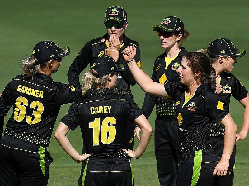 Georgia Wareham (R) celebrates one of her three Kiwi wickets in the second T20 international.